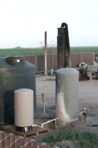 "Javan's ""new"" water pump in foreground next to her dry well hole.  Behind is the old pump, also dry. Photo by Javan Briggs"